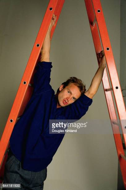 Sting Hangs from a Red Ladder