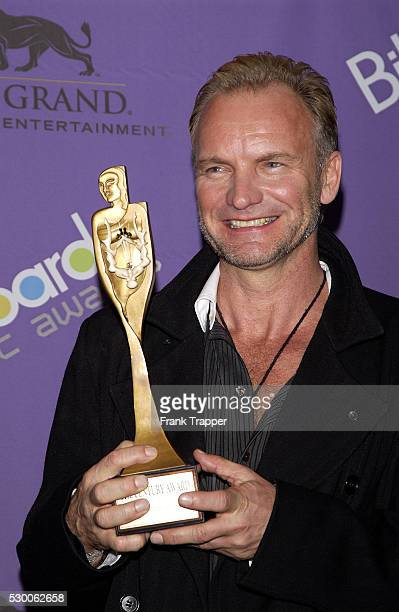 Sting in the press room with his Century Award at the 2003 Billboard Music Awards