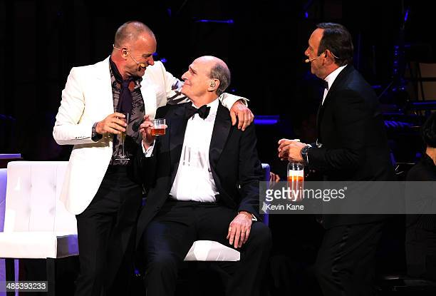 Sting James Taylor and Kevin Spacey perform onstage at The 2014 Revlon Concert For The Rainforest Fund at Carnegie Hall on April 17 2014 in New York...