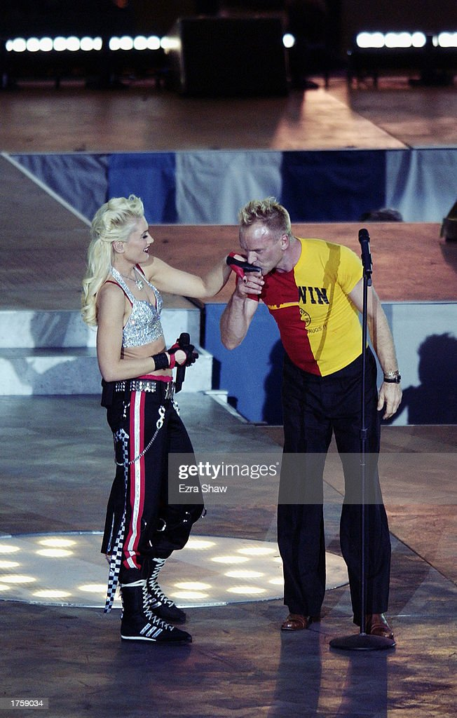 Sting kisses the hand of singer Gwen Stefani of No Doubt after their duet of the Police hit 'Message in a Bottle' during the half-time show of Super Bowl XXXVII between the Oakland Raiders and the Tampa Bay Buccaneers on January 26, 2003 at Qualcomm Stadium in San Diego, California. The Buccaneers won 48-21.