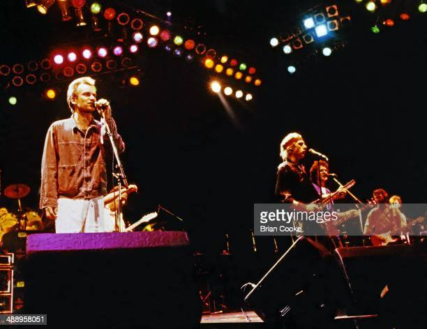 Sting performing with Dire Straits at The Princes Trust 10th Birthday Party at Wembley Arena on June 20 1986 LR Sting Mark Knopfler John Illsley and...