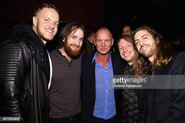 Sting poses with Dan Reynolds Daniel Platzman Ben McKee and Wayne Sermon of Imagine Dragons at The New Yorker Festival 2014 wrap party at the Top of...