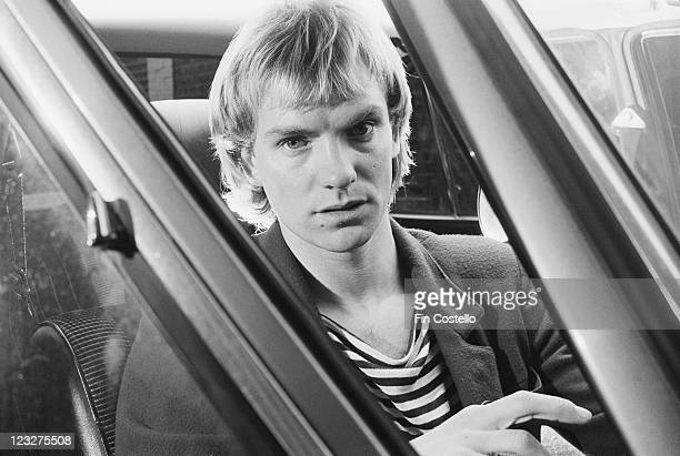 Sting singer and bassist with British rock band The Police poses sitting in the front seat of a car United Kingdom circa 1979