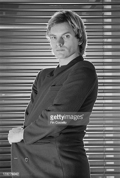 Sting singer and bassist with British rock band The Police poses in front of a window covered by a venetian blind in a studio portrait United Kingdom...