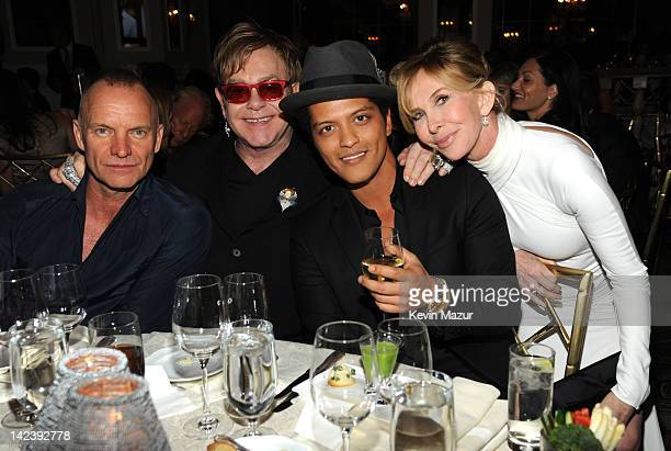 Sting Sir Elton John Bruno Mars and Trudie Styler during the auction following the Revlon concert for the Rainforest Fund at The Pierre Hotel on...