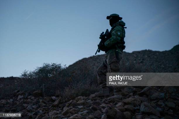 Stinger a member of Constitutional Patriots New Mexico Border Ops Team militia is pictured on patrol at the USMexico border near Mt Christo Rey in...