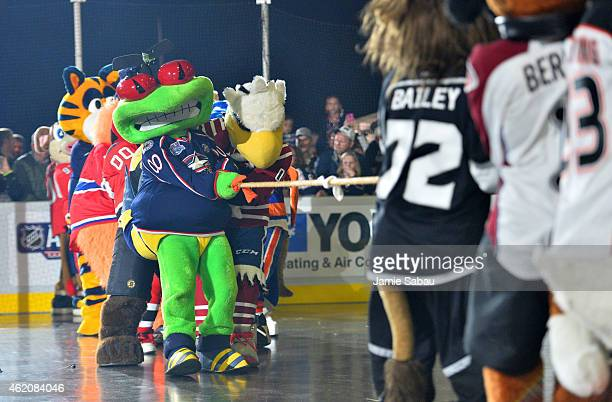 Stinger of the Columbus Blue Jackets and Slapshot of the Washington Capitals compete in the tug of war during the mascot showdown as part of the 2015...