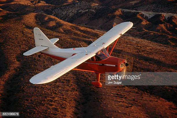 1947 stinson station wagon aircraft in flight - 1947 stock pictures, royalty-free photos & images