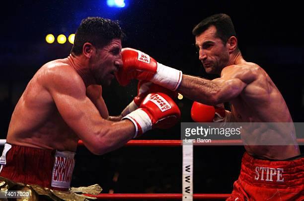 Stipe Drews of Croatia hits Silvio Branco of Italy during the WBA Light Heavyweight Championship fight between Stipe Drews and Silvio Branco at the...