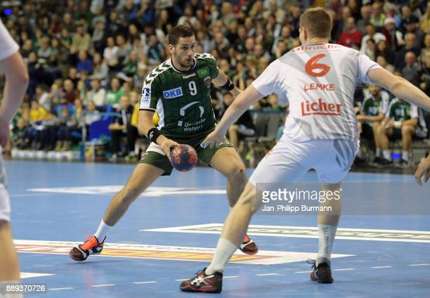 Stipe Mandalinic of Fuechse Berlin and Finn Lemke of MT Melsungen during the game between Fuechse Berlin and dem MT Melsungen on december 10 2017 in...