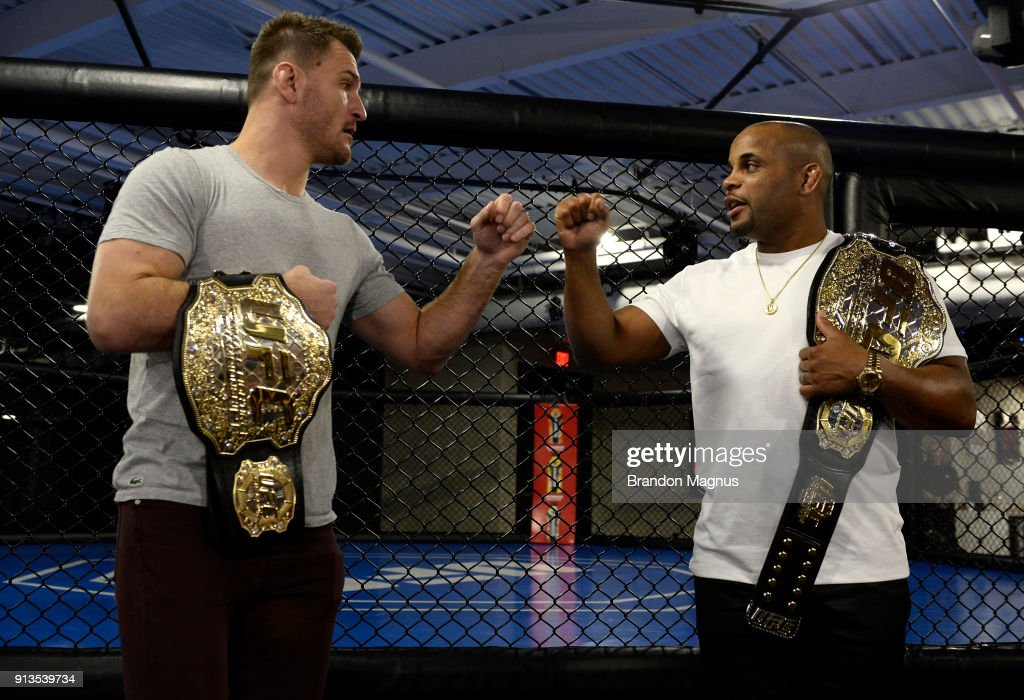 Stipe Miocic and Daniel Cormier bump fists during the The Ultimate Fighter: Undefeated Cast & Coaches Media Day inside the UFC Performance institute on February 2, 2017 in Las Vegas, Nevada.