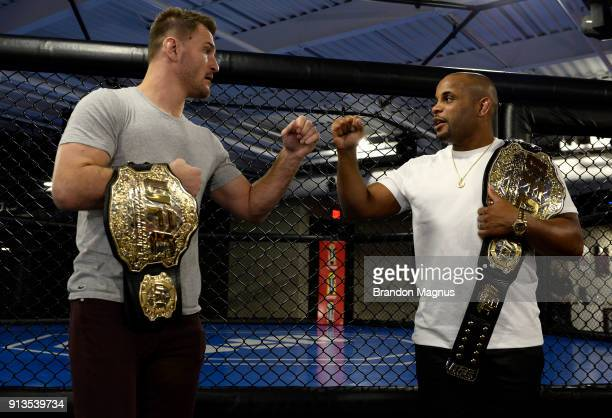 Stipe Miocic and Daniel Cormier bump fists during the The Ultimate Fighter Undefeated Cast Coaches Media Day inside the UFC Performance institute on...