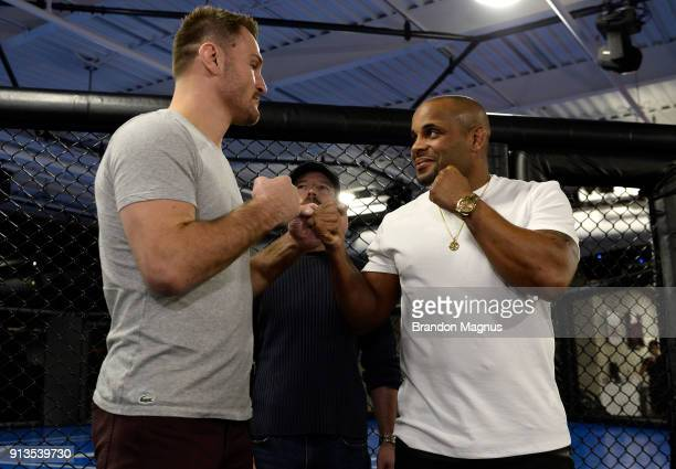 Stipe Miocic and Daniel Cormier face off during the The Ultimate Fighter Undefeated Cast Coaches Media Day inside the UFC Performance institute on...