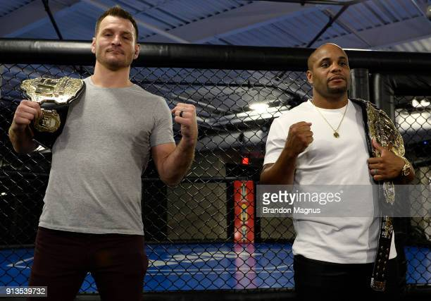 Stipe Miocic and Daniel Cormier pose for the media during the The Ultimate Fighter Undefeated Cast Coaches Media Day inside the UFC Performance...