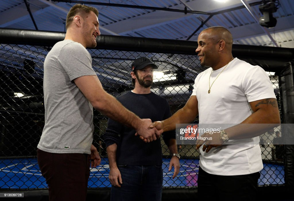 Stipe Miocic and Daniel Cormier shake hands during the The Ultimate Fighter: Undefeated Cast & Coaches Media Day inside the UFC Performance institute on February 2, 2017 in Las Vegas, Nevada.