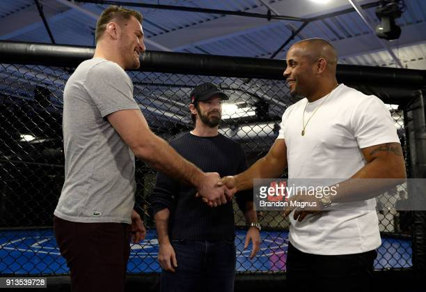 Stipe Miocic and Daniel Cormier shake hands during the The Ultimate Fighter Undefeated Cast Coaches Media Day inside the UFC Performance institute on...