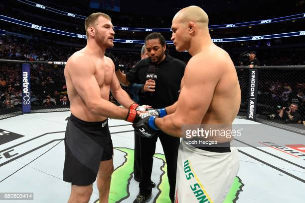 Stipe Miocic and Junior Dos Santos face off in their UFC heavyweight championship fight during the UFC 211 event at the American Airlines Center on...