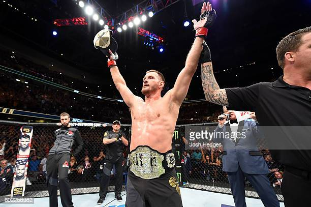 Stipe Miocic celebrates after defeating Alistair Overeem of The Netherlands in their UFC heavyweight championship bout during the UFC 203 event at...