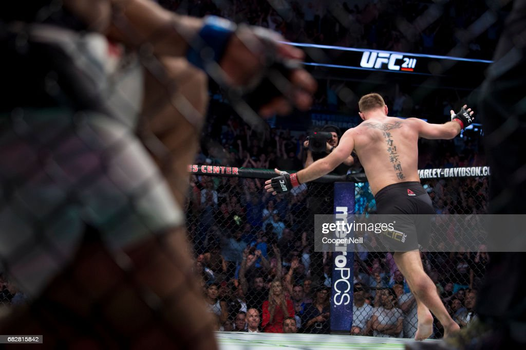 Stipe Miocic celebrates after defeating Junior dos Santos during UFC 211 at the American Airlines Center on May 13, 2017 in Dallas, Texas.