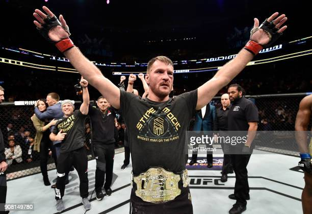 Stipe Miocic celebrates after his unanimousdecision victory over Francis Ngannou of Cameroon in their heavyweight championship bout during the UFC...