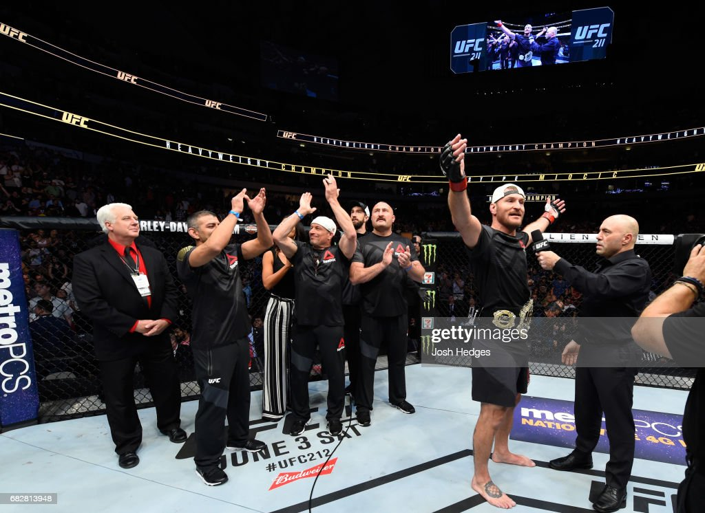Stipe Miocic celebrates his TKO victory over Junior Dos Santos in their UFC heavyweight championship fight during the UFC 211 event at the American Airlines Center on May 13, 2017 in Dallas, Texas.
