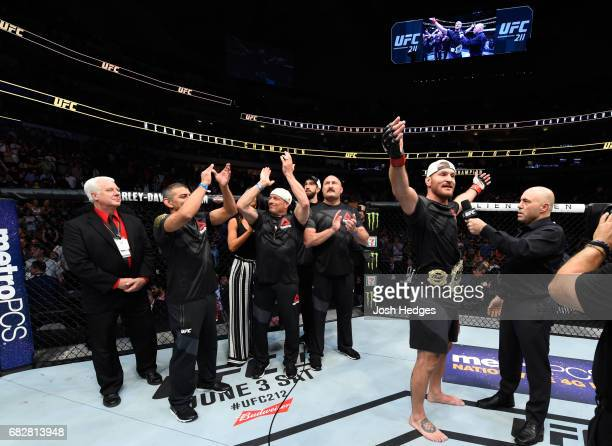 Stipe Miocic celebrates his TKO victory over Junior Dos Santos in their UFC heavyweight championship fight during the UFC 211 event at the American...