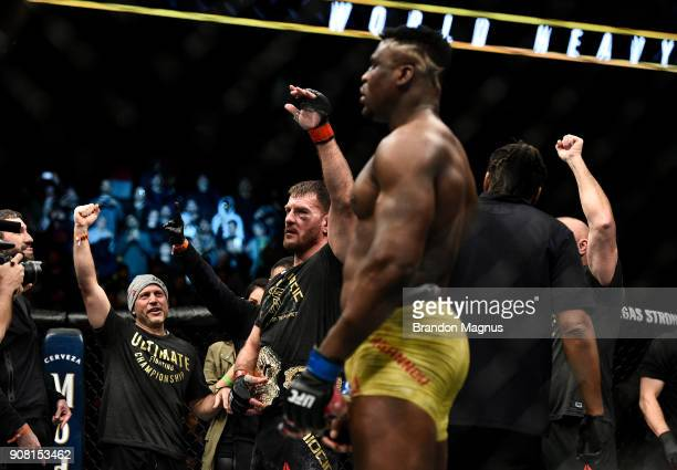 Stipe Miocic celebrates his victory over Francis Ngannou of Cameroon in their heavyweight championship bout during the UFC 220 event at TD Garden on...
