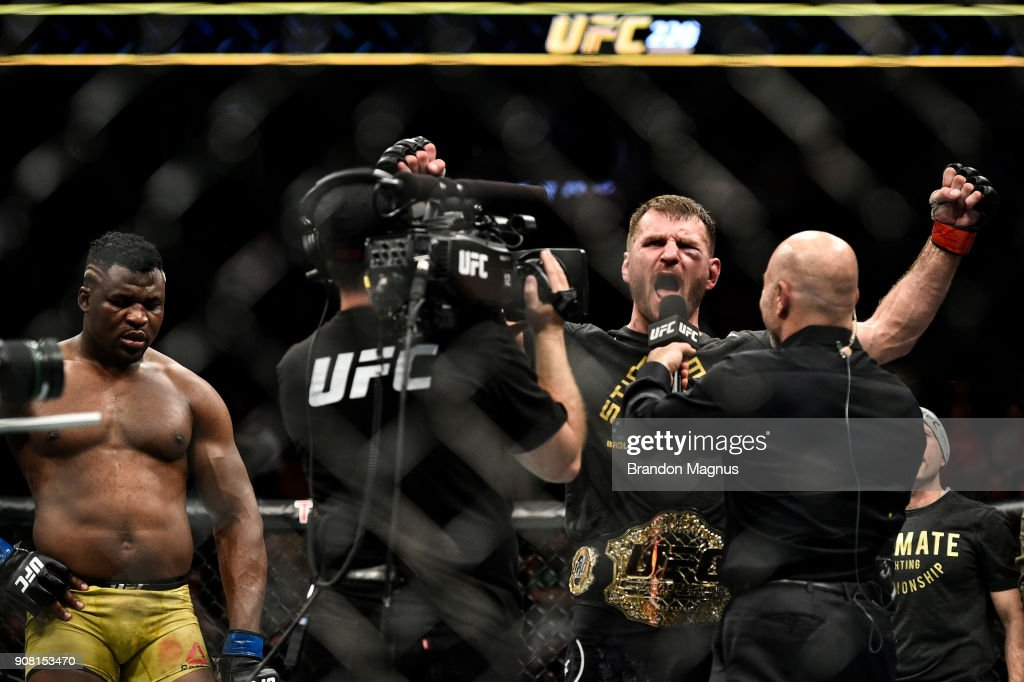 Stipe Miocic celebrates his victory over Francis Ngannou of Cameroon in their heavyweight championship bout during the UFC 220 event at TD Garden on January 20, 2018 in Boston, Massachusetts.