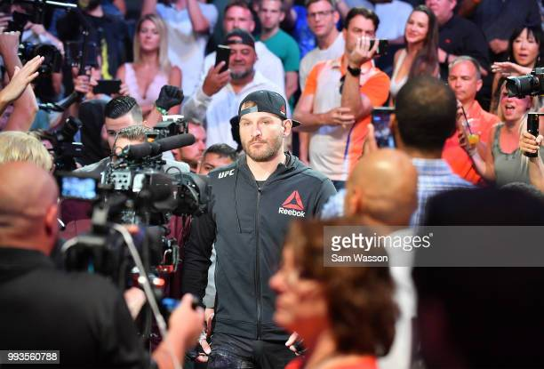 Stipe Miocic enters the arena before his heavyweight championship fight against Daniel Cormier at TMobile Arena on July 7 2018 in Las Vegas Nevada...
