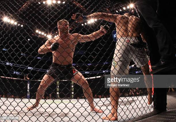 Stipe Miocic fights against Junior Dos Santos in their Heavyweight Title bout during UFC 211 at American Airlines Center on May 13 2017 in Dallas...