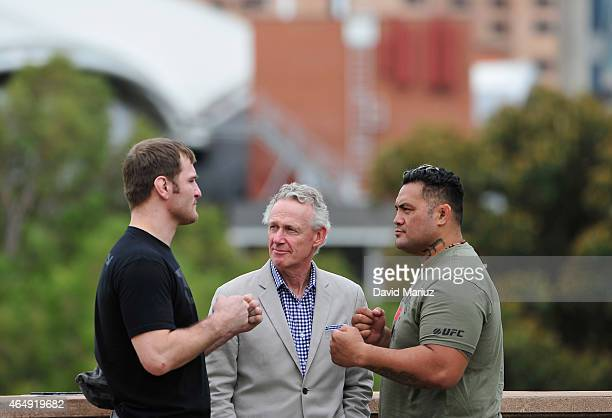 Stipe Miocic No 4 ranked UFC heavy weight Tom Wright UFC Vice President and Mark Hunt No 5 ranked UFC heavy weight pose during the UFC Adelaide Media...