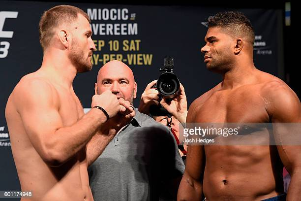 Stipe Miocic of the United States and Alistair Overeem of the Netherlands face off during the UFC 203 Weighin at Quicken Loans Arena on September 9...