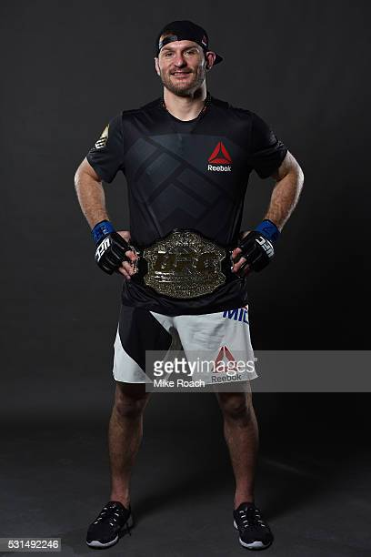 Stipe Miocic poses with his new UFC heavyweight championship belt backstage during the UFC 198 event at Arena da Baixada stadium on May 14 2016 in...