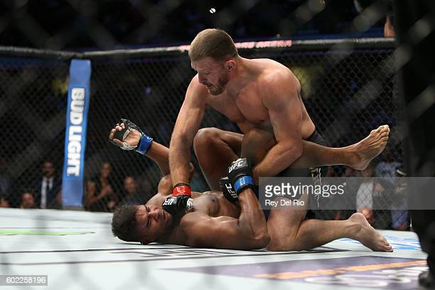 Stipe Miocic punches Alistair Overeem during the UFC 203 event at Quicken Loans Arena on September 10 2016 in Cleveland Ohio