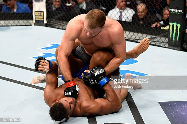Stipe Miocic punches Alistair Overeem of The Netherlands in their UFC heavyweight championship bout during the UFC 203 event at Quicken Loans Arena...