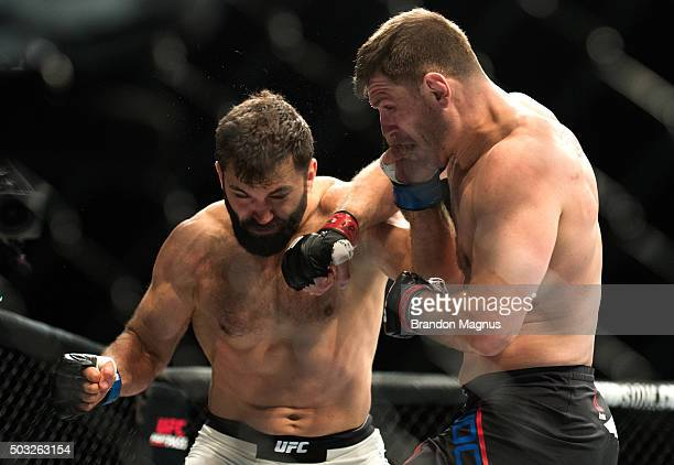 Stipe Miocic punches Andrei Arlovski in their heavyweight fight during the UFC 195 event inside MGM Grand Garden Arena on January 2, 2016 in Las...