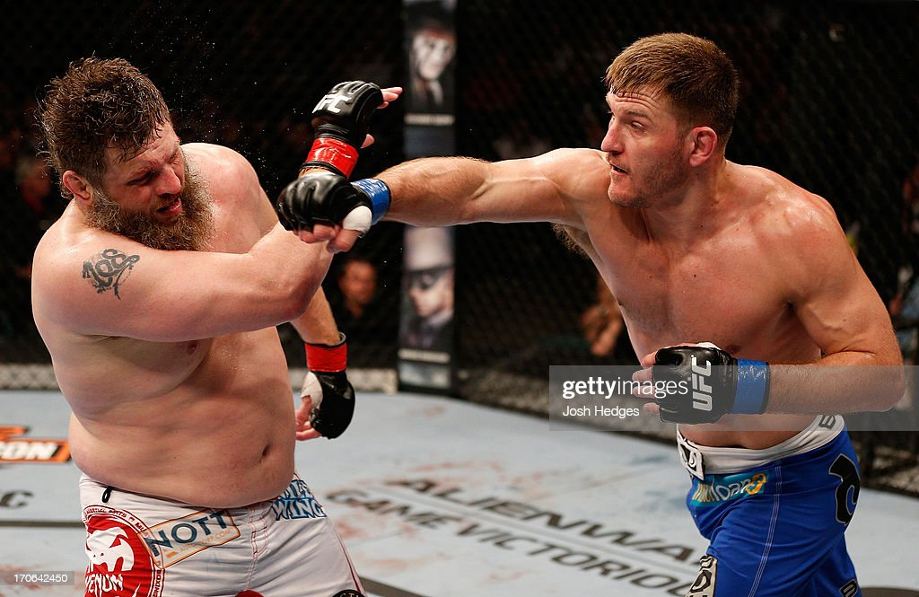 Stipe Miocic punches 'Big Country' Roy Nelson in their heavyweight fight during the UFC 161 event at the MTS Centre on June 15, 2013 in Winnipeg, Manitoba, Canada.