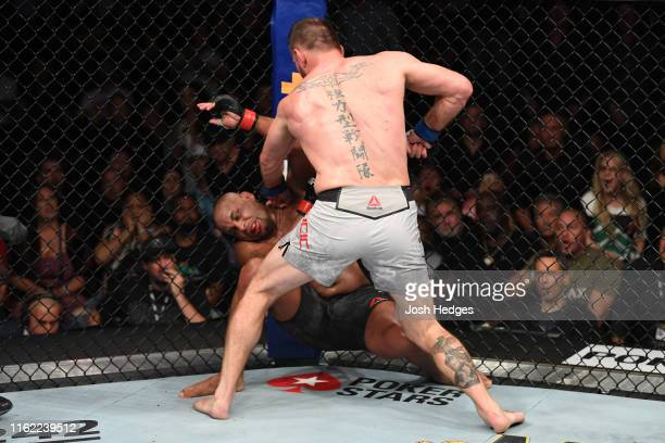 Stipe Miocic punches Daniel Cormier in their heavyweight championship bout during the UFC 241 event at the Honda Center on August 17, 2019 in...