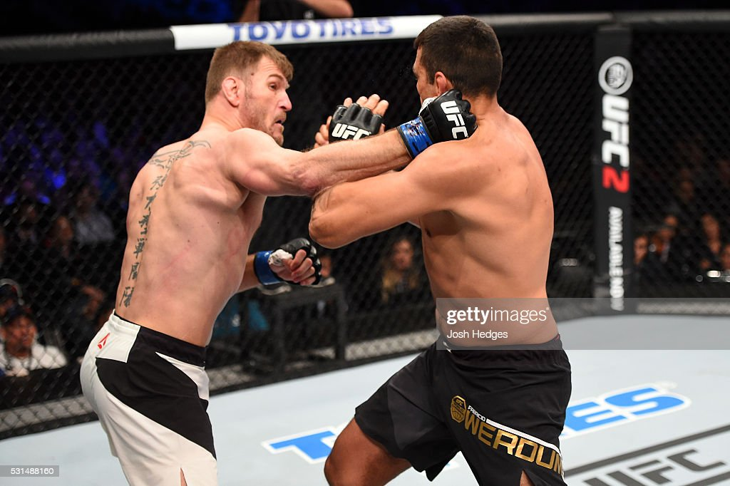Stipe Miocic punches Fabricio Werdum of Brazil in their UFC heavyweight championship bout during the UFC 198 event at Arena da Baixada stadium on May 14, 2016 in Curitiba, Parana, Brazil.