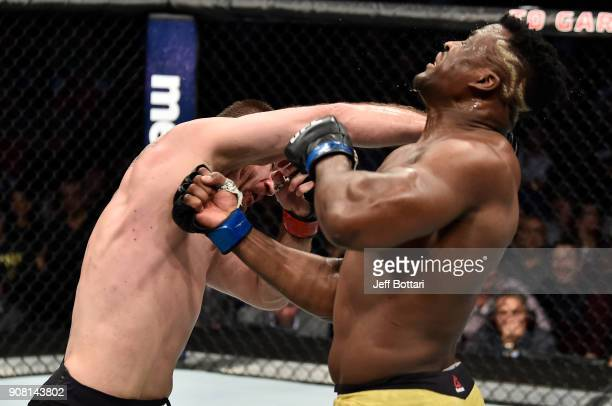 Stipe Miocic punches Francis Ngannou of Cameroon in their heavyweight championship bout during the UFC 220 event at TD Garden on January 20 2018 in...