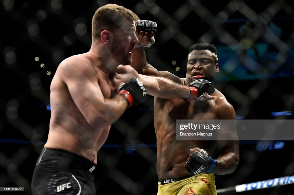 Stipe Miocic punches Francis Ngannou of Cameroon in their heavyweight championship bout during the UFC 220 event at TD Garden on January 20, 2018 in Boston, Massachusetts.