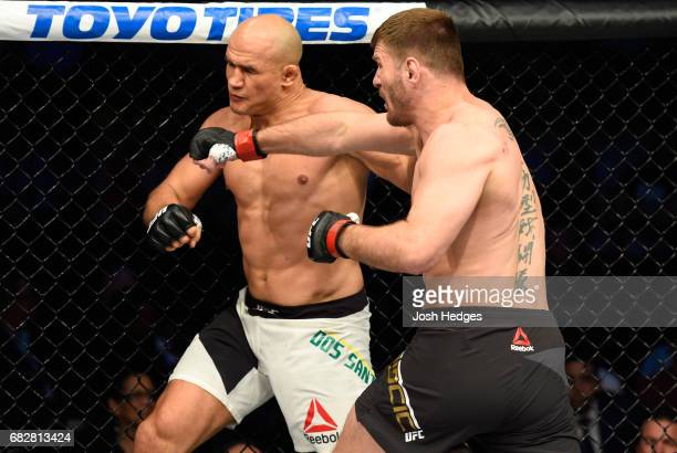 Stipe Miocic punches Junior Dos Santos in their UFC heavyweight championship fight during the UFC 211 event at the American Airlines Center on May 13...