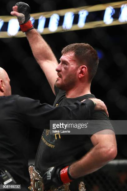 Stipe Miocic reacts after defeating Francis Ngannou by unanimous decision in their Heavyweight Championship fight during UFC 220 at TD Garden on...