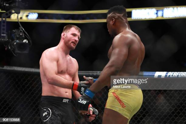 Stipe Miocic reacts at the end of the fifth round against Francis Ngannou in their Heavyweight Championship fight during UFC 220 at TD Garden on...