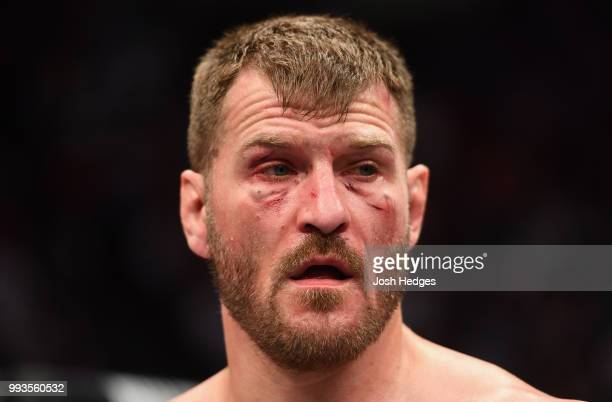 Stipe Miocic reacts to his knockout loss to Daniel Cormier in their UFC heavyweight championship fight during the UFC 226 event inside TMobile Arena...