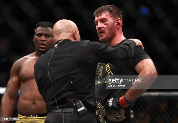 Stipe Miocic speaks to Joe Rogan after defeating Francis Ngannou in their Heavyweight Championship fight during UFC 220 at TD Garden on January 20...