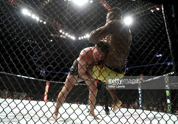 Stipe Miocic takes down Francis Ngannou in their Heavyweight Championship fight during UFC 220 at TD Garden on January 20 2018 in Boston Massachusetts