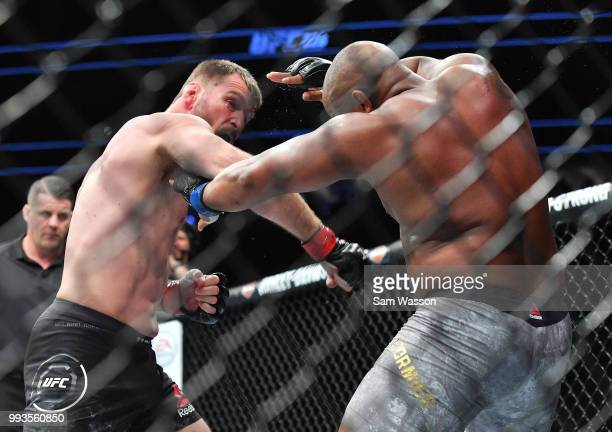 Stipe Miocic throws a punch against Daniel Cormier during their heavyweight championship fight at TMobile Arena on July 7 2018 in Las Vegas Nevada...