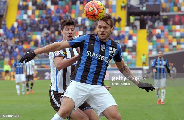 Stipe Perica of Udinese Calcio competes with Rafael Toloi of Atalanta BC during the Serie A match between Udinese Calcio v Atalanta BC at Stadio...