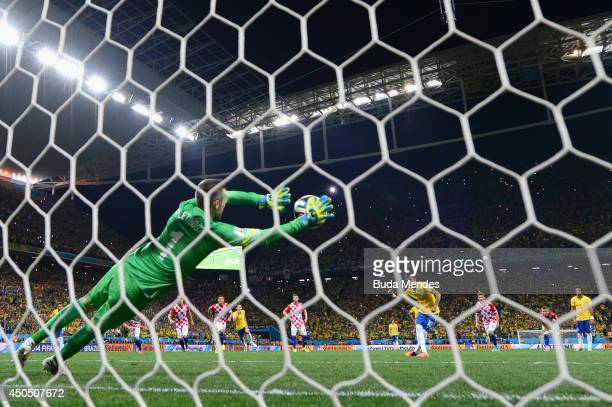 Stipe Pletikosa of Croatia dives attempting to save a penalty kick taken by Neymar of Brazil in the second half during the 2014 FIFA World Cup Brazil...